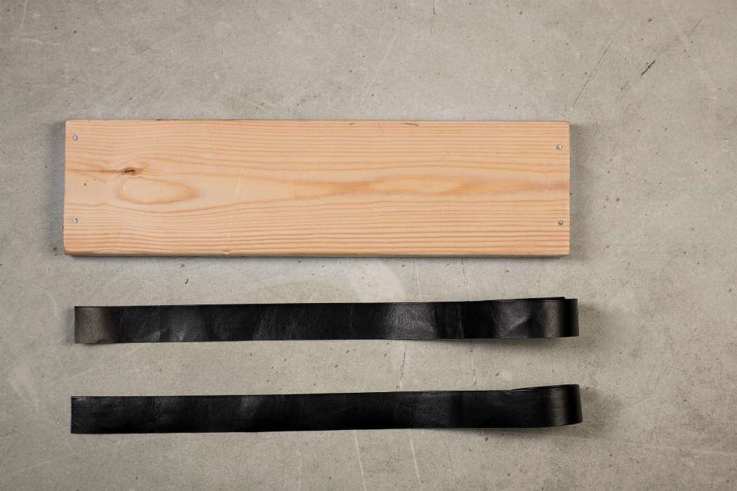 Wooden shelf 2 black leather straps