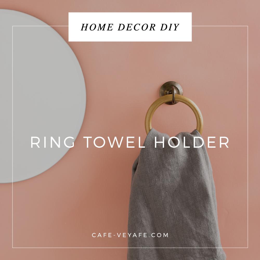 pink wall round mirror golden hoop towel hanger