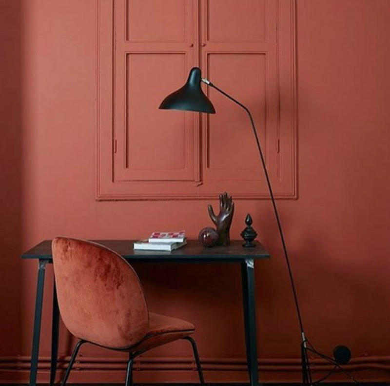 rust red teracota color gubi chair and wall trends interior design