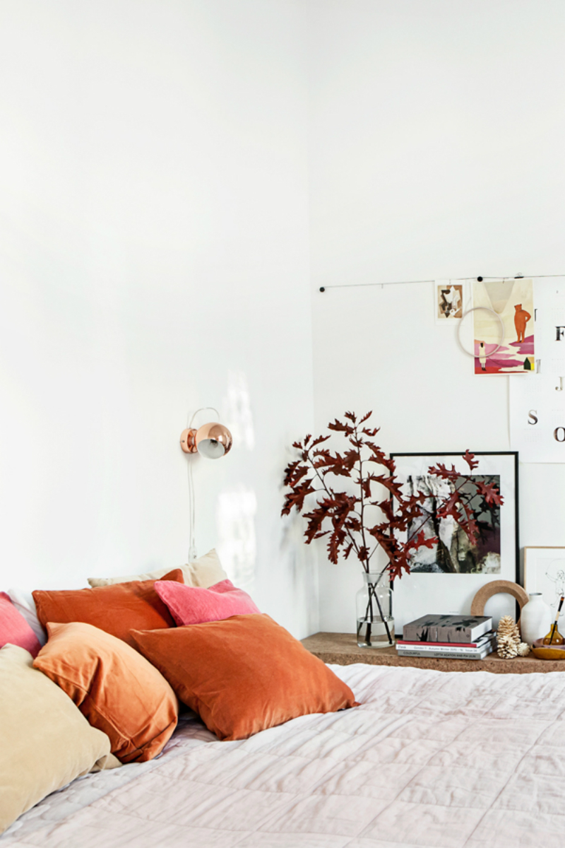 a touch of orange in a monochromatic apartment design