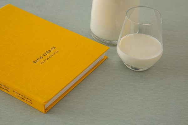 yellow coffee table book and milk