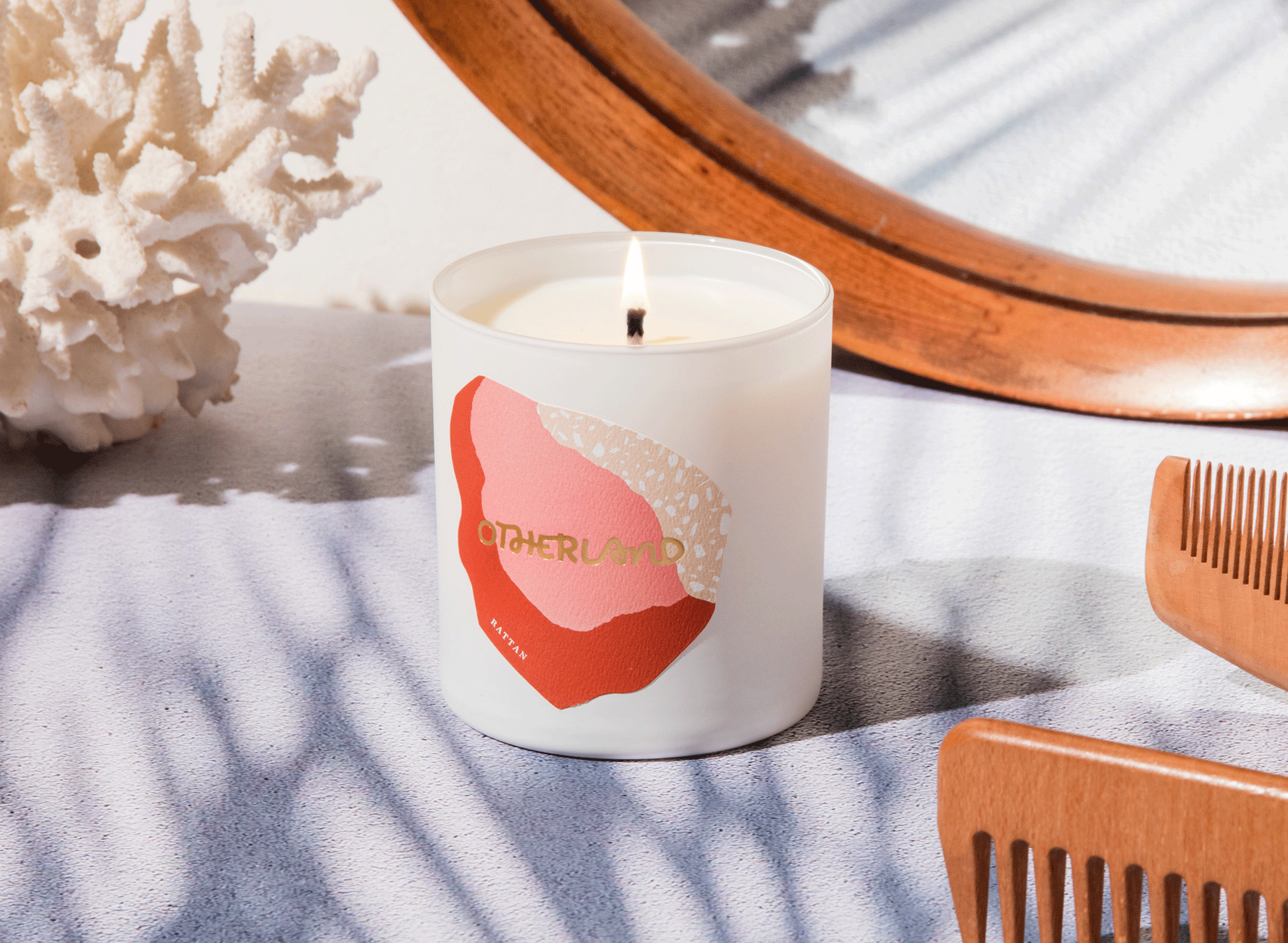 scented candle in terracota and coral