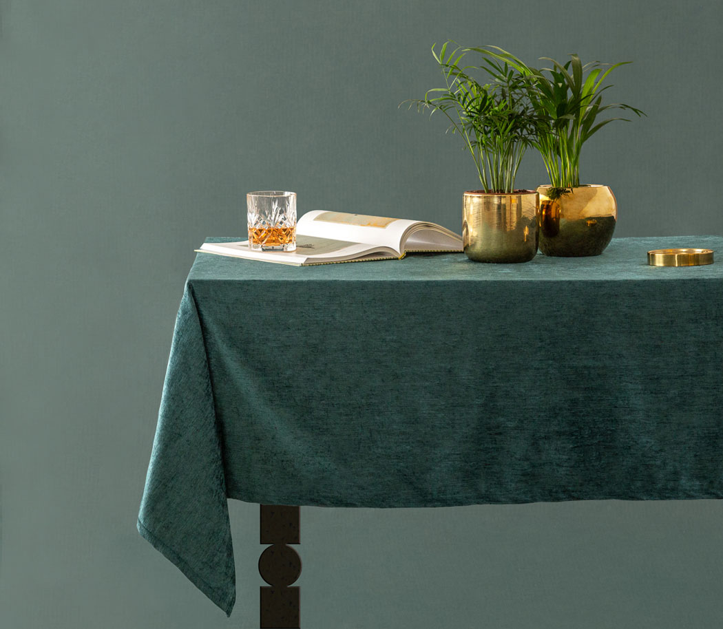 rich hedonistic tablescape with crystal whisky glass and palm leaves