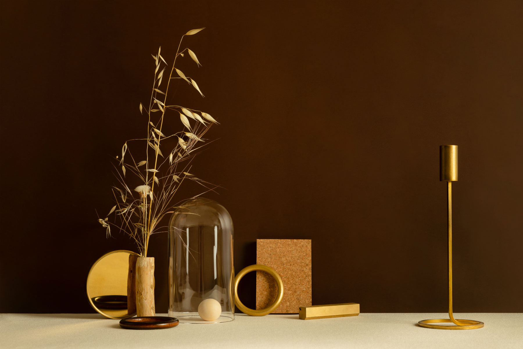 brown earth tones with gold and corck still life editorial