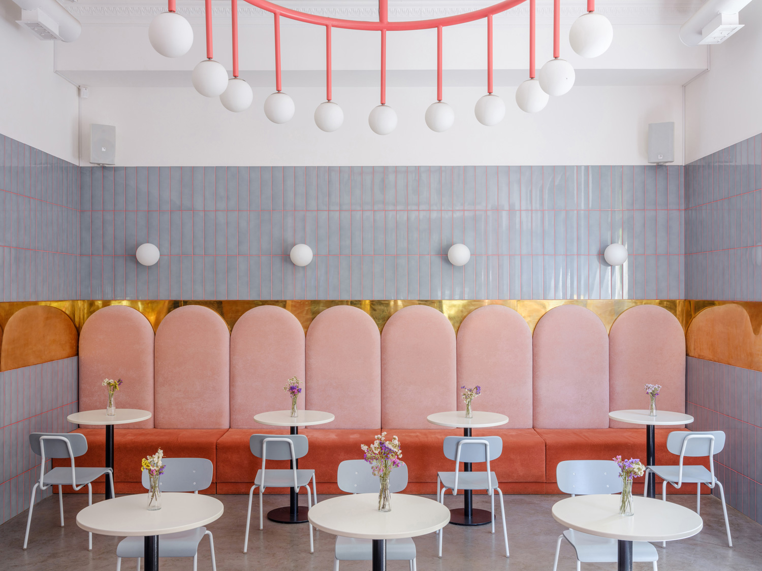 bakery interior design with living coral accents