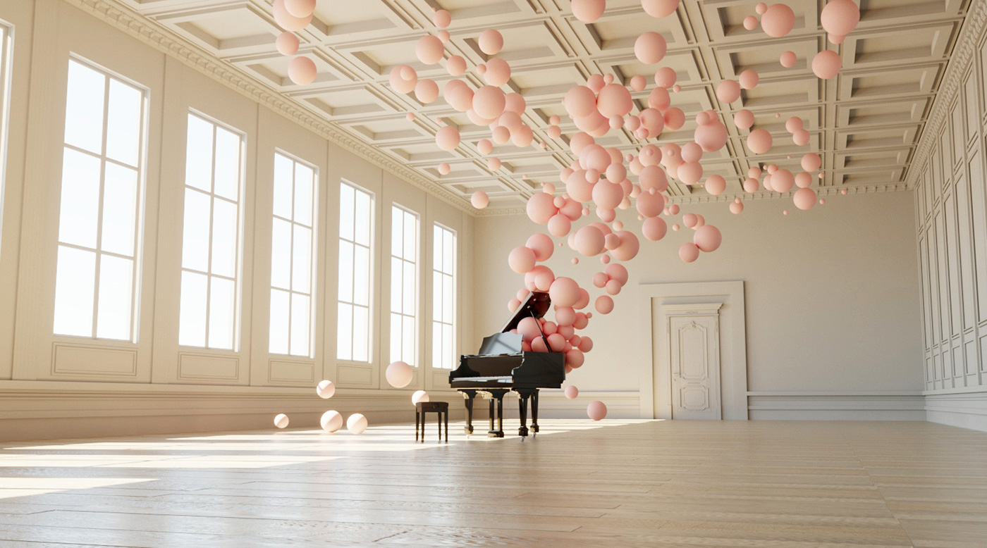 grand piano in well lit large studio filled with pink balloons